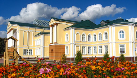 building of beautiful school on a background of flowers